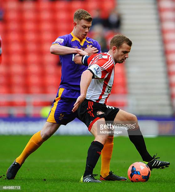 Lee Cattermole of Sunderland holds off the challenge of Jack Byrne of Kidderminster during the FA Cup Fourth Round match between Sunderland and...