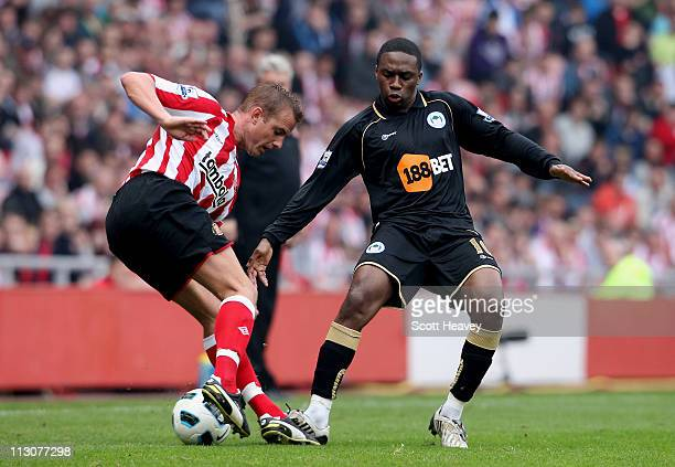 Lee Cattermole of Sunderland in action with Charles N'Zogbia of Wigan in action during the Barclays Premier League match between Sunderland and Wigan...