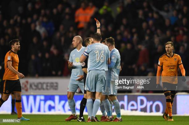 Lee Cattermole of Sunderland is shown a red card during the Sky Bet Championship match between Wolverhampton and Sunderland at Molineux on December 9...