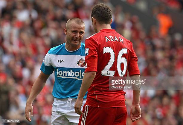 Lee Cattermole of Sunderland reacts after a challenge by Charlie Adam of Liverpool during the Barclays Premier League match between Liverpool and...