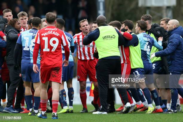 Lee Cattermole of Sunderland speaks to Adebayo Akinfenwa of Wycombe as tempers flare during the Sky Bet League One match between Wycombe Wanderers...