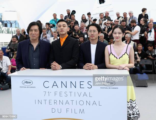 Lee ChangDong Yoo Ahin Steven Yeun and Jun Jong Seo attend the 'Burning' Photocall during the 71st annual Cannes Film Festival at Palais des...