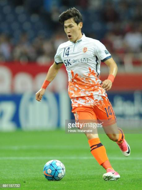 Lee Changmin of Jeju United FC in action during the AFC Champions League Round of 16 match between Urawa Red Diamonds and Jeju United FC at Saitama...