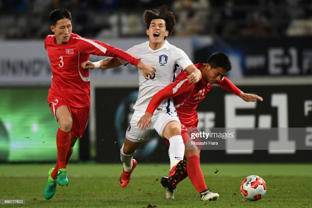 Lee Changmin (C) of South Korea competes for the ball against Jang Kuk Chol (L) and Kim Yu Song (R) of North Korea during the EAFF E-1 Men's Football Championship between North Korea and South Korea at Ajinomoto Stadium on December 12, 2017 in Chofu, Tokyo, Japan.