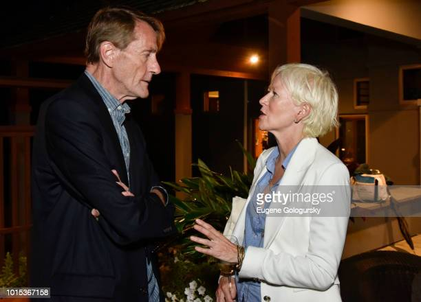 Lee Child and Joanna Coles attend Authors Night At East Hampton Library Private Dinner on August 11 2018 in East Hampton New York