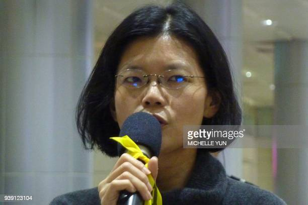 Lee Chingyu wife of jailed Taiwanese activist Lee Mingcheh speaks during a press conference at Taoyuan International Airport in Taipei on March 28...