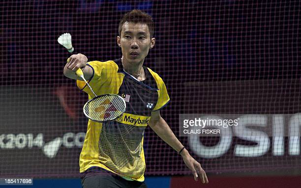 Lee Chong Wei from Malaysia plays a ball to Chen Long from China during the man single's final match of the Danish open Badminten in Odense Denmark...