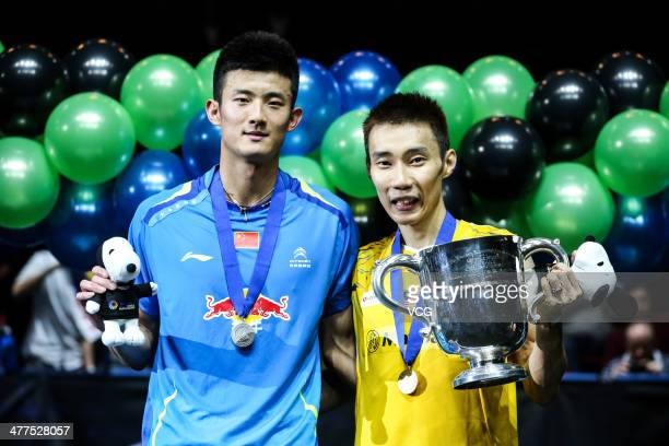 Lee Chong Wei of Malaysia and Chen Long of China pose for photograph after their All England Open Badminton Championships men's singles final match...