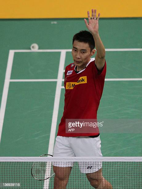 Lee Chong Wei of Malaysia celebrates his victory against Taufiq Hidayat of Indonesia during their men's quarterfinal match at the Malaysia Open...