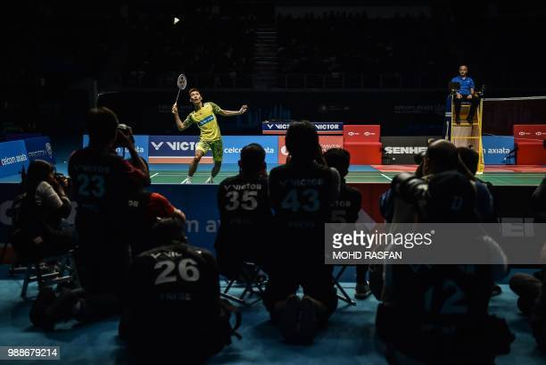 Lee Chong Wei of Malaysia eyes a return against Kento Momota of Japan in their men's singles final match at the Malaysia Open badminton tournament in...