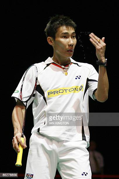 Lee Chong Wei of Malaysia gestures during his men's singles quarter final match against Ville Lang of Finland during the Badminton All England Open...