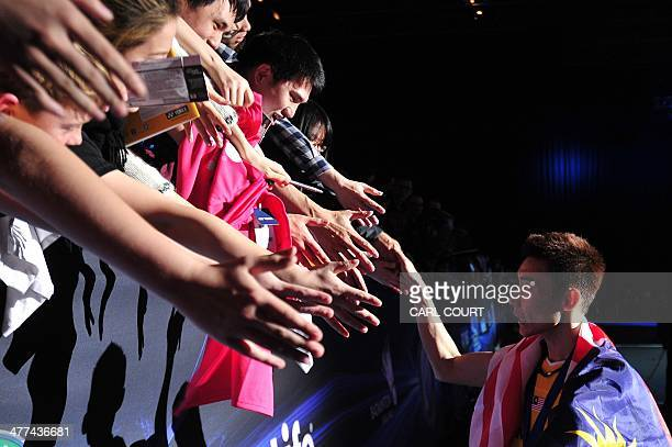 Lee Chong Wei of Malaysia greets fans after beating Chen Long of China in their All England Open Badminton Championships men's singles final match in...