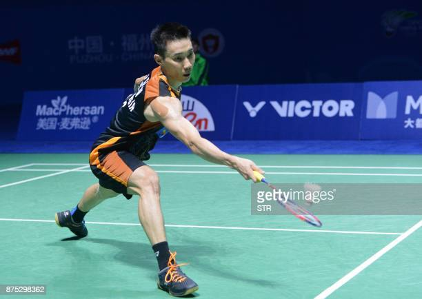 Lee Chong Wei of Malaysia hits a return against Angus Ng KaLong of Hong Kong during their men's singles quarterfinal match at the China Open 2017...