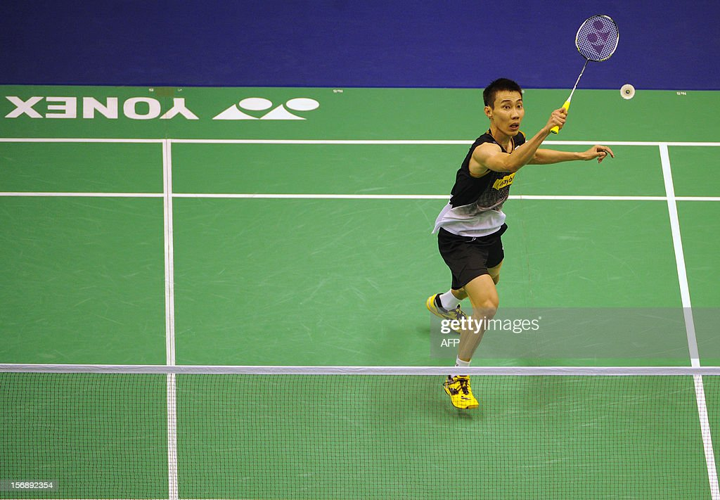 Lee Chong Wei of Malaysia hits a shot against Kenichi Tago of Japan during their men's singles semi-final match at the Hong Kong Open badminton tournament on November 24, 2012