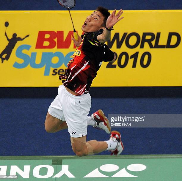 Lee Chong Wei of Malaysia jumps to smash a shuttle during men's singles quarter final against Chen Jin of China at the Proton Malaysia Open Super...