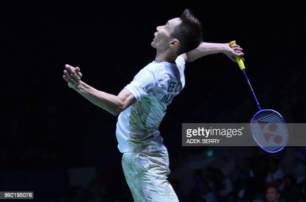 Lee Chong Wei of Malaysia plays a return against Anders Antonsen of Denmark during their men's singles badminton match at the Indonesia Open in...