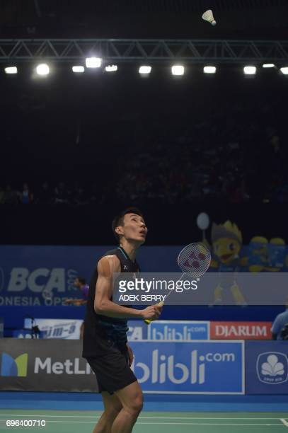 Lee Chong Wei of Malaysia plays a return against Prannoy HS of India during the men's singles badminton match at the Indonesia Open in Jakarta on...