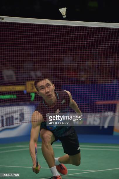 Lee Chong Wei of Malaysia plays a return agaisnt Prannoy HS of India during the men's singles badminton match at the Indonesia Open in Jakarta on...