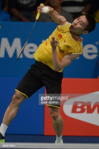 Lee Chong Wei of Malaysia returns a shuttle cock against HansKristian Vittinghus of Denmark at the 2014 Badminton Indonesia Open men singles quarter...