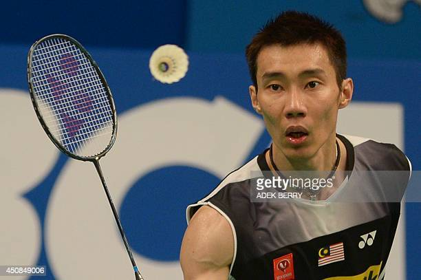 Lee Chong Wei of Malaysia returns a shuttle cock during the men singles 2nd round match against Brice Leverdez of France at the 2014 Indonesia Open...