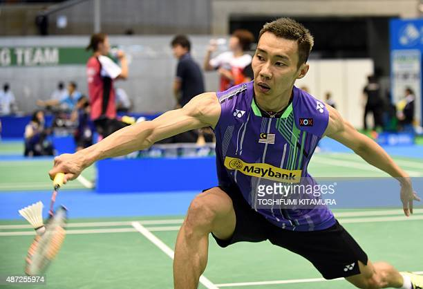 Lee Chong Wei of Malaysia returns the shuttle cock towards Alistair Casey of Scotland during their Open Japan badminton tournament qualification...