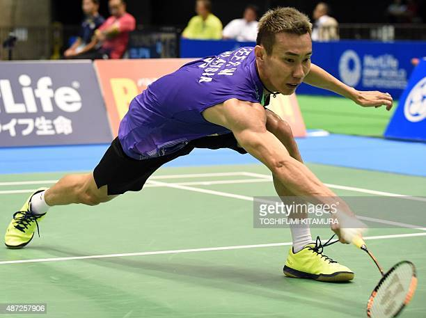 Lee Chong Wei of Malaysia returns the shuttle cock towards Kwang HeeHeo of South Korea during their Japan Open Superseries in Tokyo badminton...