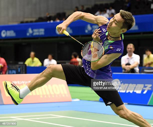 Lee Chong Wei of Malaysia smashes the shuttle cock towards Kwang HeeHeo of South Korea during their Japan Open Superseries in Tokyo badminton...