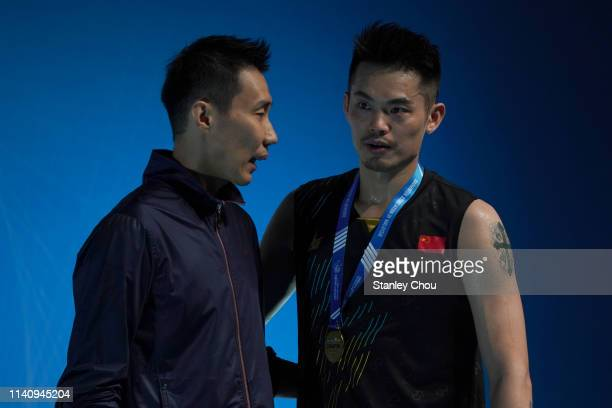 Lee Chong Wei of Malaysia speaks to Lin Dan of China during the presentation ceremony on day six of the Badminton Malaysia Open at Axiata Arena on...