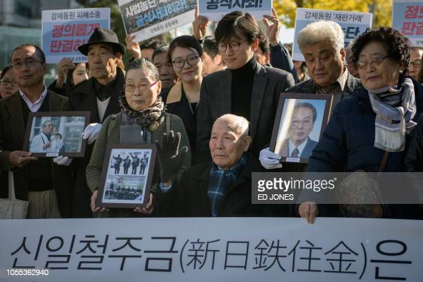 Lee Choonshik a victim of forced labour by Japan during its colonial rule of the Korean peninsula from 1910 to 1945 is surrounded by supporters and...
