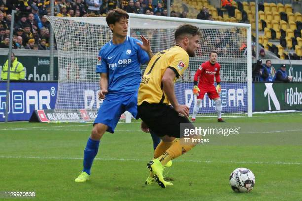Lee Chung Yong of VfL Bochum 1848 and Niklas Kreuzer of Dynamo Dresden battle for the ball during the second Bundesliga match between Dynamo Dresden...