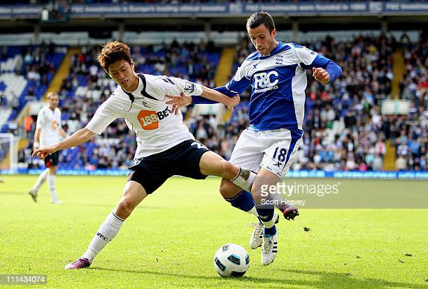 Lee ChungYong of Bolton in action with Keith Fahey of Birmingham during the Barclays Premier League match between Birmingham City and Bolton...