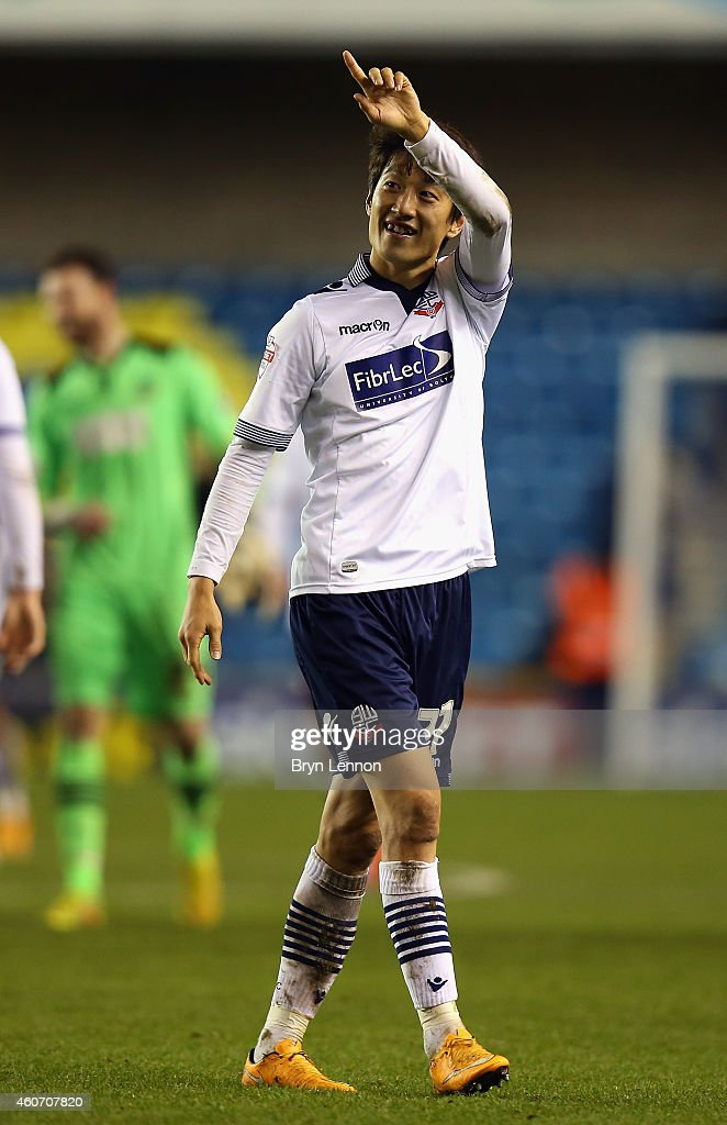 Lee Chung-Yong of Bolton Wanderers waves to fans after during the Sky Bet Championship match between Millwall and Bolton Wanderers at The Den on December 19, 2014 in London, England.