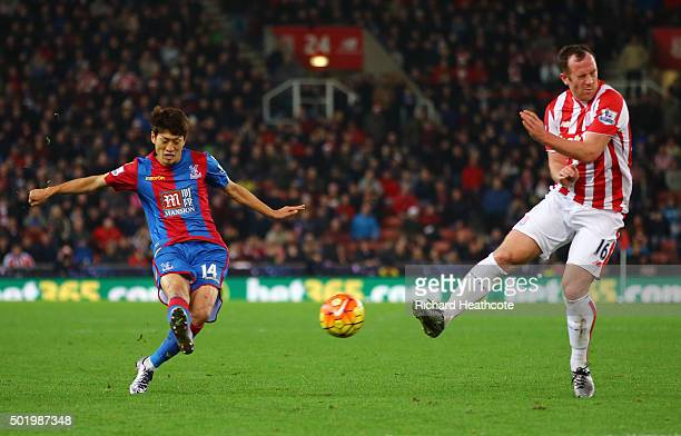 Lee Chungyong of Crystal Palace scores his team's second goal during the Barclays Premier League match between Stoke City and Crystal Palace at the...