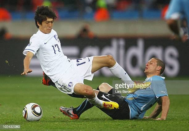 Lee Chung-Yong of South Korea catches Diego Perez of Uruguay in the chest with his boot during the 2010 FIFA World Cup South Africa Round of Sixteen...