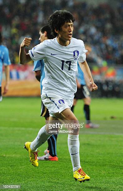 Lee Chung-Yong of South Korea celebrates scoring his team's first goal during the 2010 FIFA World Cup South Africa Round of Sixteen match between...