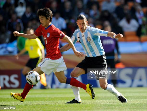 Lee ChungYong of South Korea fights for the ball with Martin Demichelis of Argentina during the 2010 FIFA World Cup South Africa Group B match...