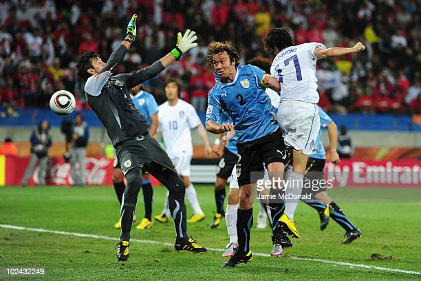 Lee Chung-Yong of South Korea scores his team's first goal past Fernando Muslera of Uruguay during the 2010 FIFA World Cup South Africa Round of...