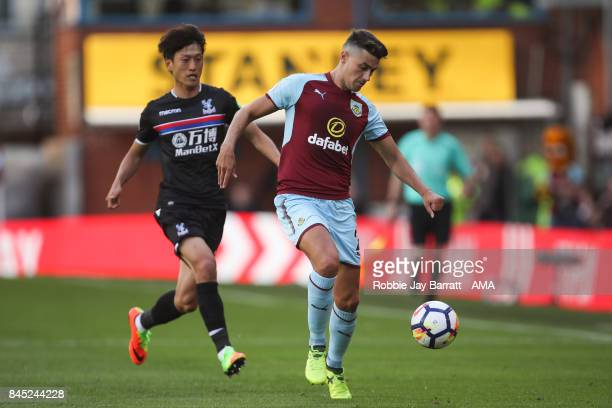 Lee ChungYoung of Crystal Palace and Matt Lowton of Burnley during the Premier League match between Burnley and Crystal Palace at Turf Moor on...