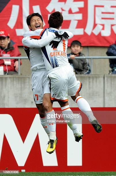 Lee Chun-Soo celebrates with teammate Chikara Fujimoto after scoring a goal during the J.League match between Kashima Antlers and Omiya Ardija at...