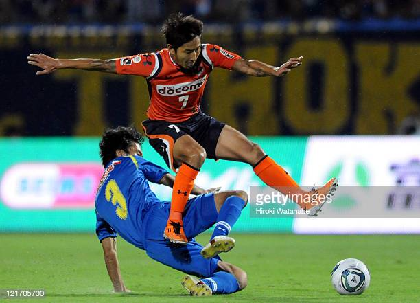 Lee ChunSoo of Omiya Ardija is tackled by Hidenori Ishii of Montedio Yamagata during the JLeague match between Omiya Ardija and Montedio Yamagata at...