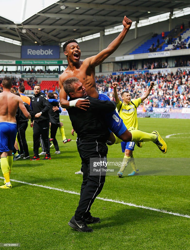 Lee Clark manager of Birmingham City and Jordon Ibe of Birmingham City celebrate as they avoid relegation after the Sky Bet Championship match between Bolton Wanderers and Birmingham City at Reebok Stadium on May 3, 2014 in Bolton, England.
