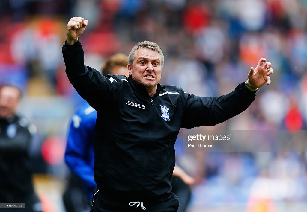 Lee Clark manager of Birmingham City celebrates as they avoid relegation after the Sky Bet Championship match between Bolton Wanderers and Birmingham City at Reebok Stadium on May 3, 2014 in Bolton, England.