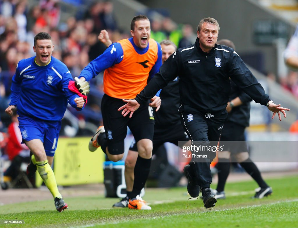 Lee Clark manager of Birmingham City celebrates with the team bencha as they avoid relegation after the Sky Bet Championship match between Bolton Wanderers and Birmingham City at Reebok Stadium on May 3, 2014 in Bolton, England.