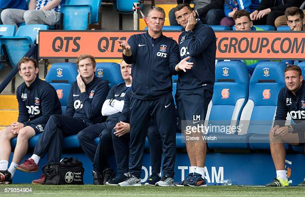 Lee Clarke Manager and assistant manager Lee McCulloch of Kilmarnock look on from the dugout during the Betfred Cup First Round between Kilmarnock...