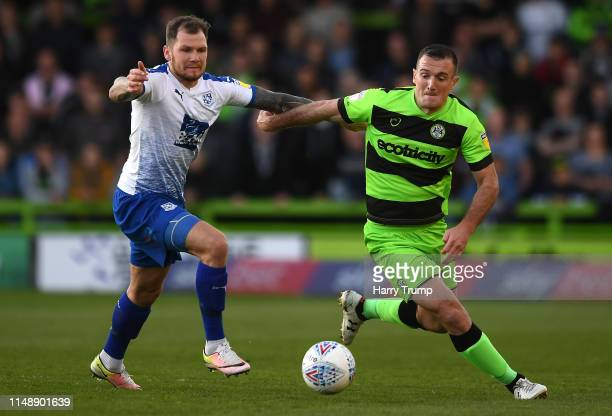 Lee Collins of Forest Green Rovers is tackled by James Norwood of Tranmere Rovers during the Sky Bet League Two Playoff Semi Final Second Leg match...