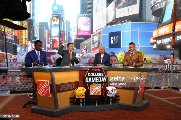 Lee Corso, Kirk Herbstreit, Chris Fowler are seen during ESPN's College GameDay show at Times Square on September 23, 2017 in New York City.