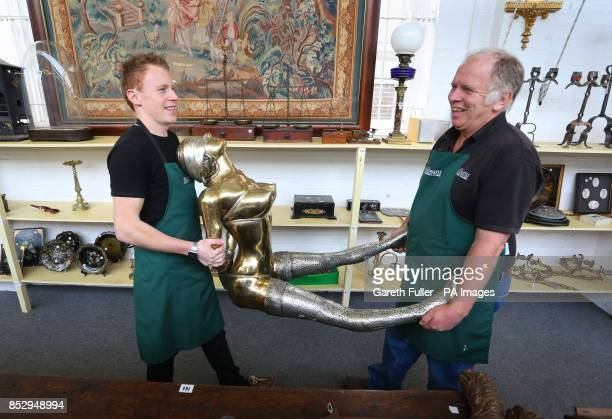 Lee Cox and Tim Allcorn sale room porters at Bellmans Auctioneers in Wisborough Green West Sussex carry a piece by Rudolfo Bucacio a gilt bronze...