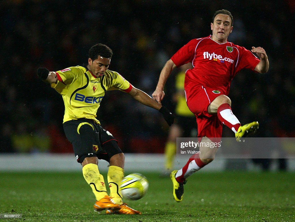Lee Croft of Norwich City tries to tackle Adrian Meriappa of Watford during the Coca Cola Championship match between Watford and Norwich City at Vicarage Road on March 04, 2008 in Watford, England.