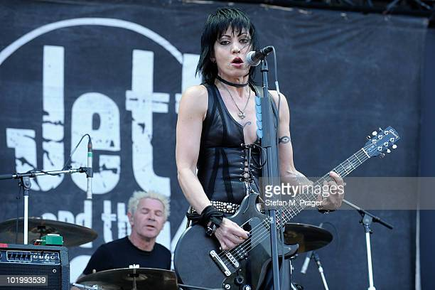 Lee Crystal and Joan Jett of Joan Jett and the Blackhearts perform on stage at Munich Reitstadion Riem on June 11 2010 in Munich Germany