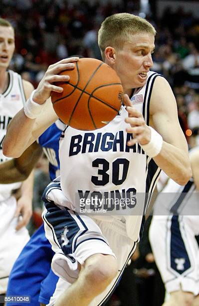 Lee Cummard of the Brigham Young University Cougars pushes the ball up the court against the Air Force Falcons during a quarterfinal game of the...